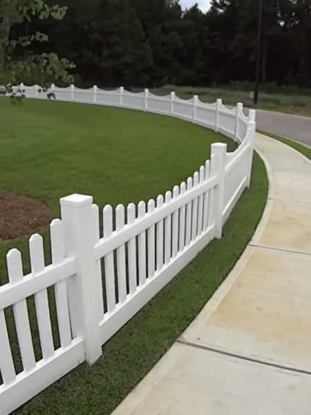 vinyl white picket fence around yard of Heath area home