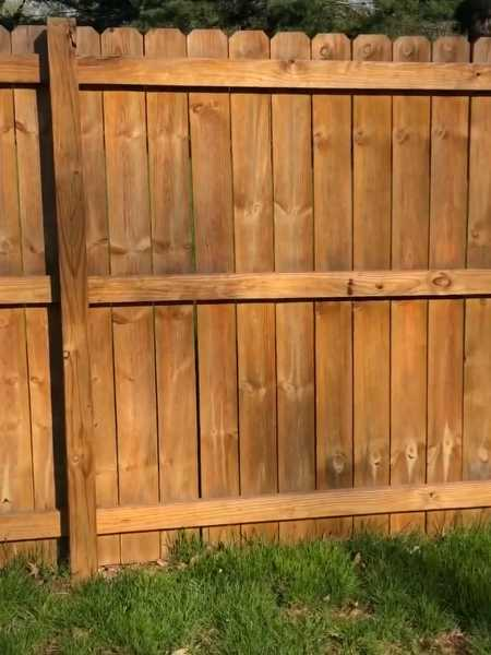 new dog eared wood privacy fence installed at Baltimore ohio home