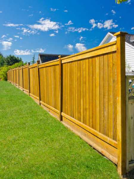 wood privacy fence installation at Baltimore area subdivision